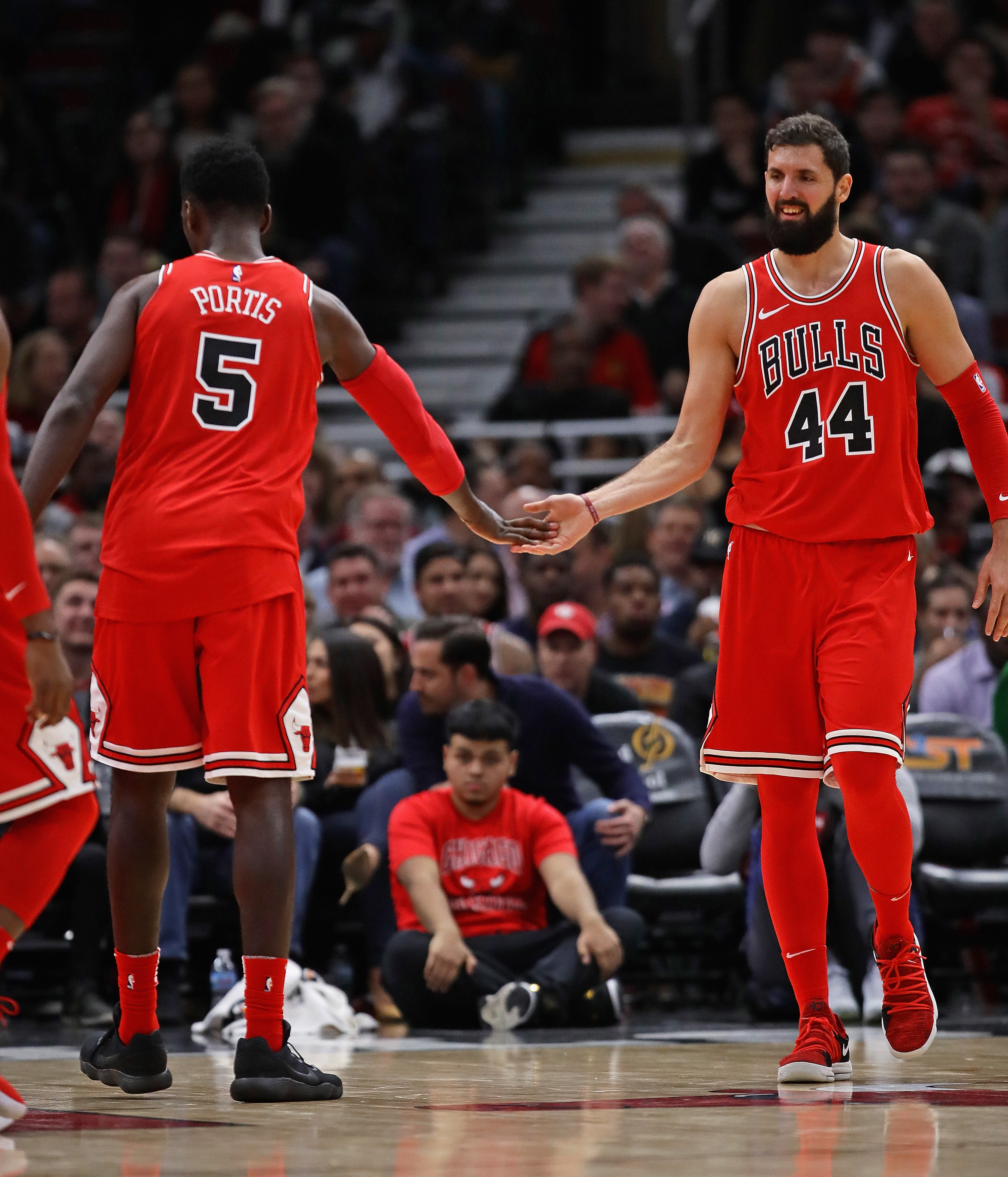 Bulls top beat-up Magic, extend streak